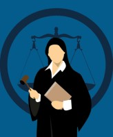 Cartoon image of judge, standing in front of the scales of justice