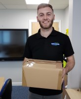Image of Shred Station staff member holding a box of waste paperwork