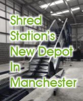 """Image of paper baler with overlay of text saying """"Shred Station's New Depot in Manchester"""""""