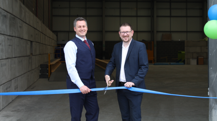 Image of Shred Station managing director, Simon Franklin, cutting the ribbon on the Manchester shredding depot with local MP, Andrew Gwynne.