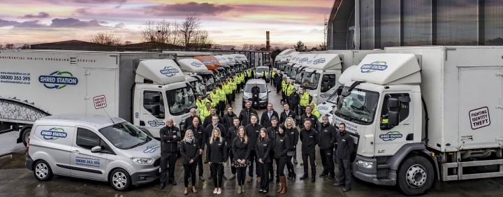 Image of Shred Station staff and large fleet of shredding trucks