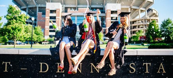 Image of three newly graduated females celebrating