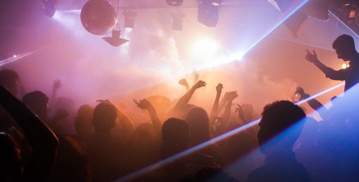 Image of young people enjoying themselves in a night club