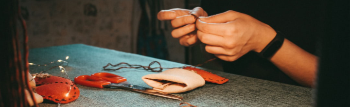 Image of person stiching a handmade Christmas stocking