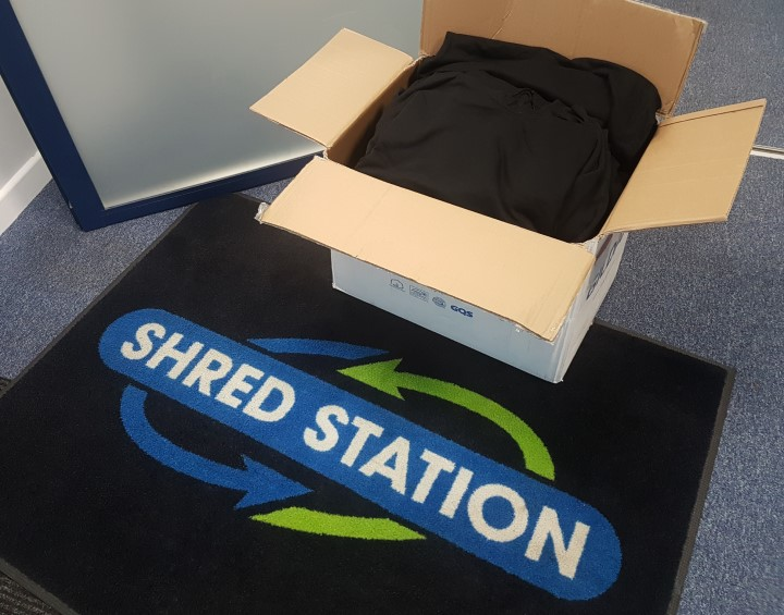 Box of hoodies that Shred Station donated to Salvation Army Norwich Citadel for their soup kitchen in Norwich