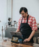 Image of Man in a Café Bar, taken by Nathan Dumlao on Unsplash